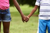 Children In Love Black Boy And Girl Holding Hands