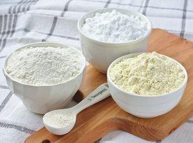 foto of millet  - Three bowls with gluten free flour  - JPG