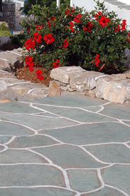 image of stone floor  - typical stone walkway and walls with flowers greek islands - JPG