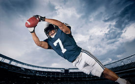image of incredible  - American Football Player Catching a touchdown Pass - JPG