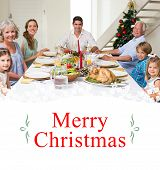 Composite image of family having christmas meal together against border