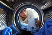Man Accidentally Dyeing Laundry Inside Washing Machine