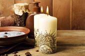 Beautiful spa composition with decorative Indian candles, on wooden table