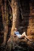 young woman relax under the tree