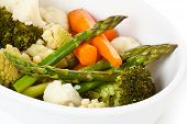 pic of steam  - Closeup shot of steamed vegetables on white plate - JPG