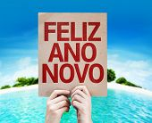 Happy New Year (in Portuguese) card with a beach on background