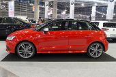 VALENCIA, SPAIN - DECEMBER 4, 2014: A red 2015 Audi S1 Sportback car at the Valencia Automovil 2014 Car Show.