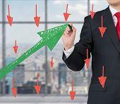 Businessman Drawing Green Graph