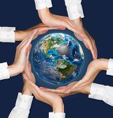Hands Holding Earth.