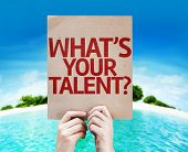 Whats Your Talent? card with a beach on background