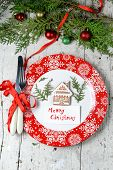 Christmas Decoration For The Table With Red Dish And Cutlery
