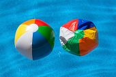 two colorful plastic balls next to each other, symbolic photo for difference, change, aging