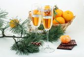 New Year's still-life with a pine branch, champagne and tangerines