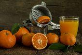 stock photo of juicer  - Still Life orange patterned on old wood and antique juicer - JPG