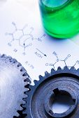 Chemistry Formula With Green Flask And Mechanical Cogwheels