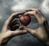 Broken Red Heart In Hands