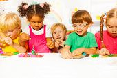 picture of kindergarten  - Group of kids in the kindergarten play with modeling clay in the class - JPG