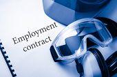 Employment Contract With Goggles, Earphones And Helmet