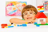 Close portrait of boy in glasses with blocks