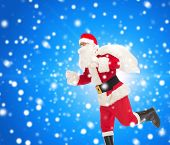 christmas, holidays and people concept - man in costume of santa claus running with bag over blue snowy background