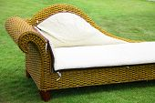 wicker sofa on a lawn
