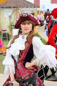 Girl In Beautiful Medieval Dress And Holds Rapier Hilt By Hand At Fest