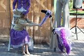 Perm, Russia - Jun, 23, 2014: Woman Feeds Bird Puppet At Puppet Shows In Gorky Park