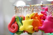 Small Soft Multicolored Bunnies And Snakes Keychains Hang In Shop. Shallow Dof