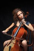 pic of cello  - Photo of a beautiful female musician playing a cello - JPG
