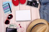 Travel things for traveling on wooden background top view