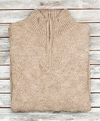Sweater On Wooden Background Isolated