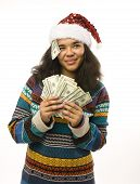 cute young african girl in santas red hat with money isolated