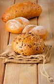 Fresh Healthy Natural Bread On  A Wooden Board