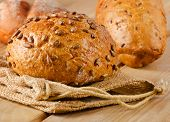Fresh Healthy Natural Bread On  Wooden Table