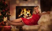 Beautiful Adult Woman, Looking At Camera, By Fireplace At Home