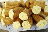 stock photo of churros  - Group of typical churros at a stall - JPG