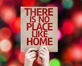 There Is No Place Like Home card with colorful background with defocused lights