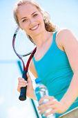 Pretty Sportswoman With Racket On Shoulders