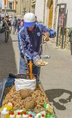 LA PAZ, BOLIVIA, MAY 8, 2014: Street seller of nuts