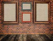 Old Frames On A Bricks Wall.