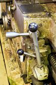 stock photo of turn-up  - handles of tailstock of metal lathe machine close up in turning workshop - JPG