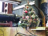 Old Decorated Christmas Tree In Workshop