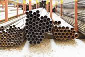 Piles Of Steel Pipes In Outdoor Warehouse