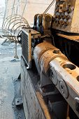 picture of bender  - reinforcing steel cutting and bender machine close up in outdoor workshop - JPG