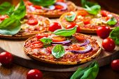 Homemade pizza with  basil, tomatos and onion