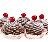 chocolate cupcake with fresh berries isolated on a white background