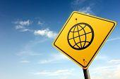Globalization Area Ahead. Yellow Traffic Sign.