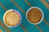 stock photo of citronella  - Dried lemon grass and coriander seeds aromatic condiments - JPG
