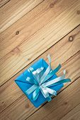 Vintage gift box on old wooden background