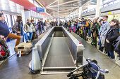 People Wait At Baggage Belt  In  Tegel Airport